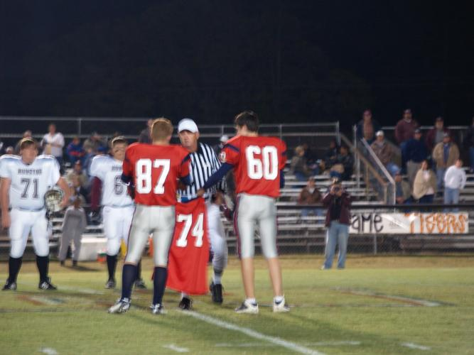 Captains carring Christopher jersey out for coin toss